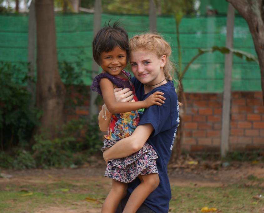 Southeast Asia - High School Girl with Cambodian Child