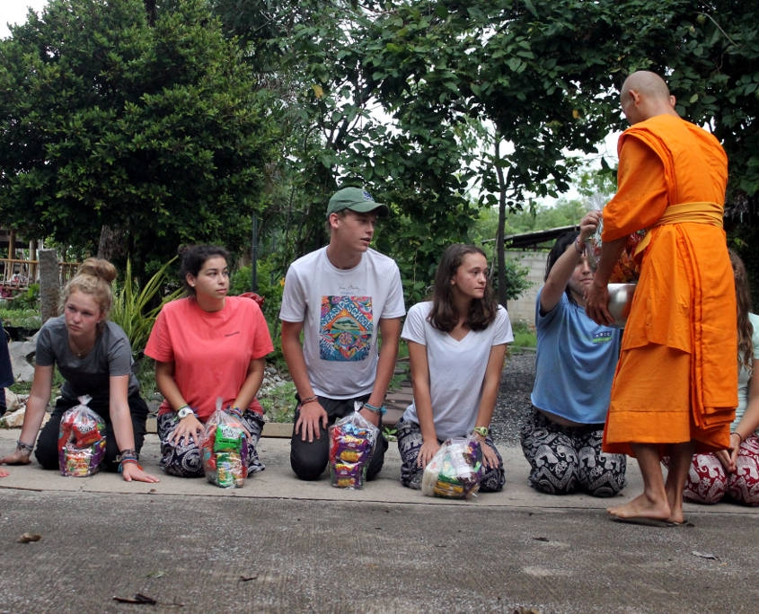 Thailand Hill Tribe Impact - Student receiving alms