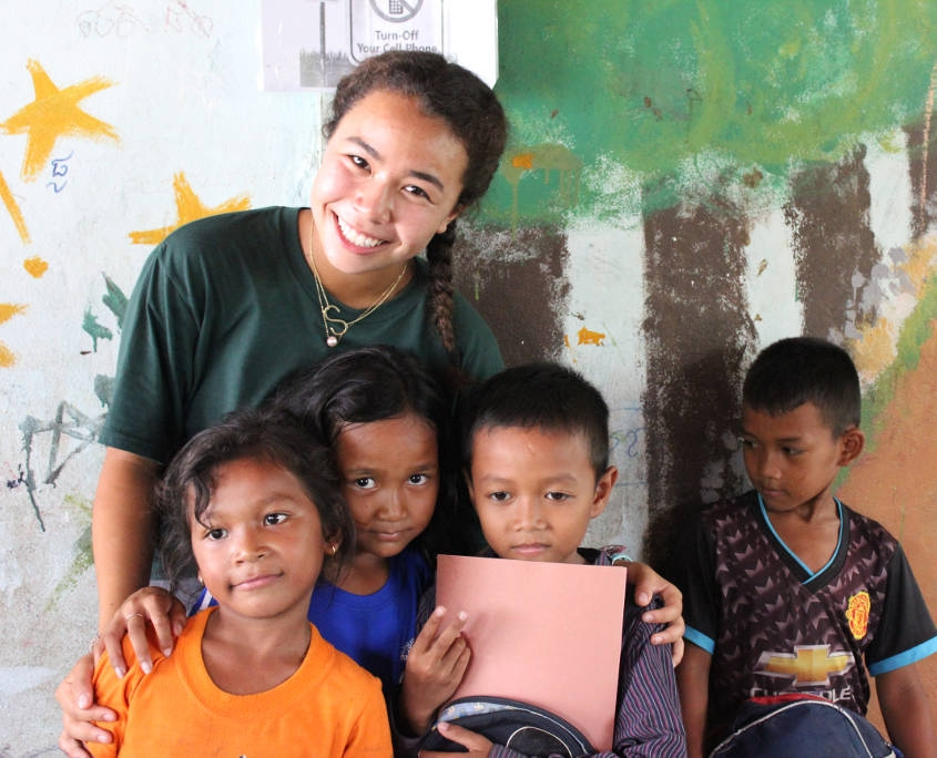 Vietnam_Cambodia - Student posing with locals after English class